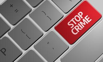 Computer keyboard with word Stop Crime.jpeg